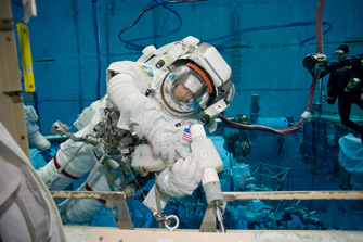 Photo: Scene of extravehicular activity training in NASA's pool (Source of photo: JAXA/NASA)