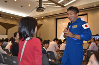 Wakata approached the child to answer a question (Credit: JAXA)