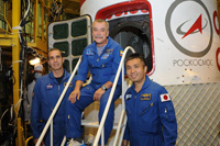 Wakata and other backup crew members pose for a commemorative photo in front of the actual Soyuz spacecraft (Credit: S.P.Korolev RSC Energia)