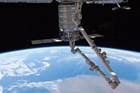 若田宇宙飛行士が操作するSSRMSによりハーモニーに結合されたシグナス補給船(Orb-1)