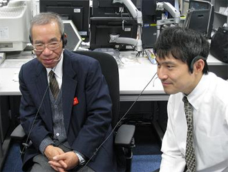 Co-Investigators Sugimura (Professor of the Kyoto Institute of Technology) and Nagaoka (Assitant Professor of the Kyoto Institute of Technology) monitoring the experiment at the User Operations Area (UOA), TKSC