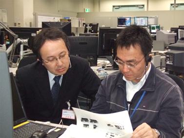 Hideki Sakai, Associate Professor of Tokyo University of Science (left) and Kenji Endo, Nanoskeleton Project manager at Toyko University of Science(right) reviewing the experiment procedures that Astronaut Noguchi performs