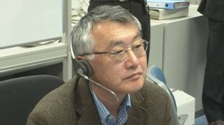 Prof. Kudo monitors the proceeding from the User Operations Area at the Tsukuba Space Center (TKSC).