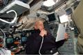 アトランティス号の後方フライトデッキで第3回船外活動の支援を行うパトリック・フォレスター宇宙飛行士(飛行8日目)
