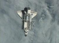 写真:ISSからの分離後にISSから撮影されたディスカバリー号(飛行13日目)